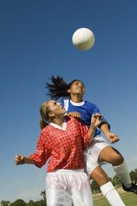 Girls heading ball