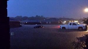 Cars damaged by flash flood