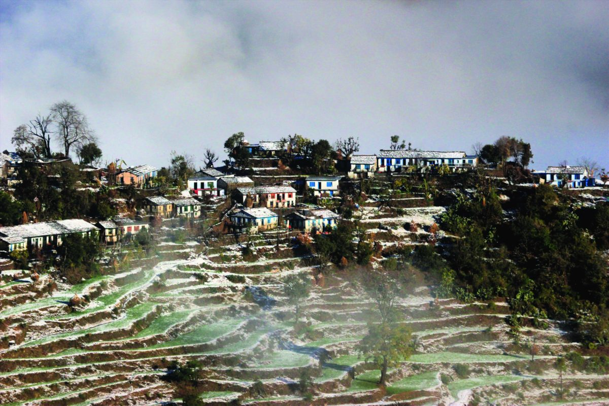 View of Naugaon village from Chalni Cheena, clicked during the winters after a heavy snowfall. Mist can be seen rising at the back.