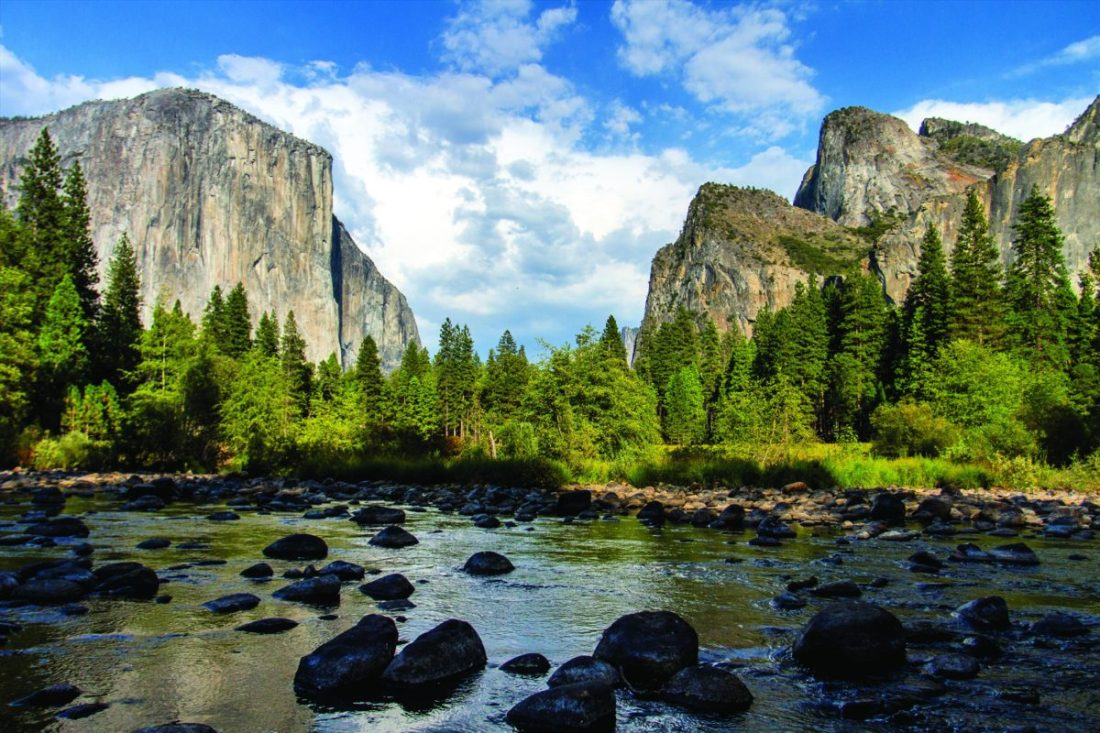 A view of Yosemite landmarks including the rock formations of El Capitan and the Three Brothers.