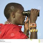 https://www.megapixl.com/masai-scout-with-binoculars-looks-for-animals-during-a-tourist-game-drive-at-the-lewa-wildlife-conservancy-in-north-kenya-africa-stock-photo-52319221