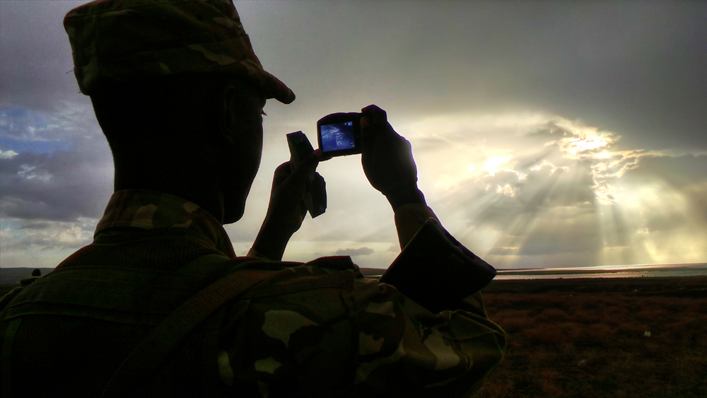 turkana eclipse_soldier taking pic