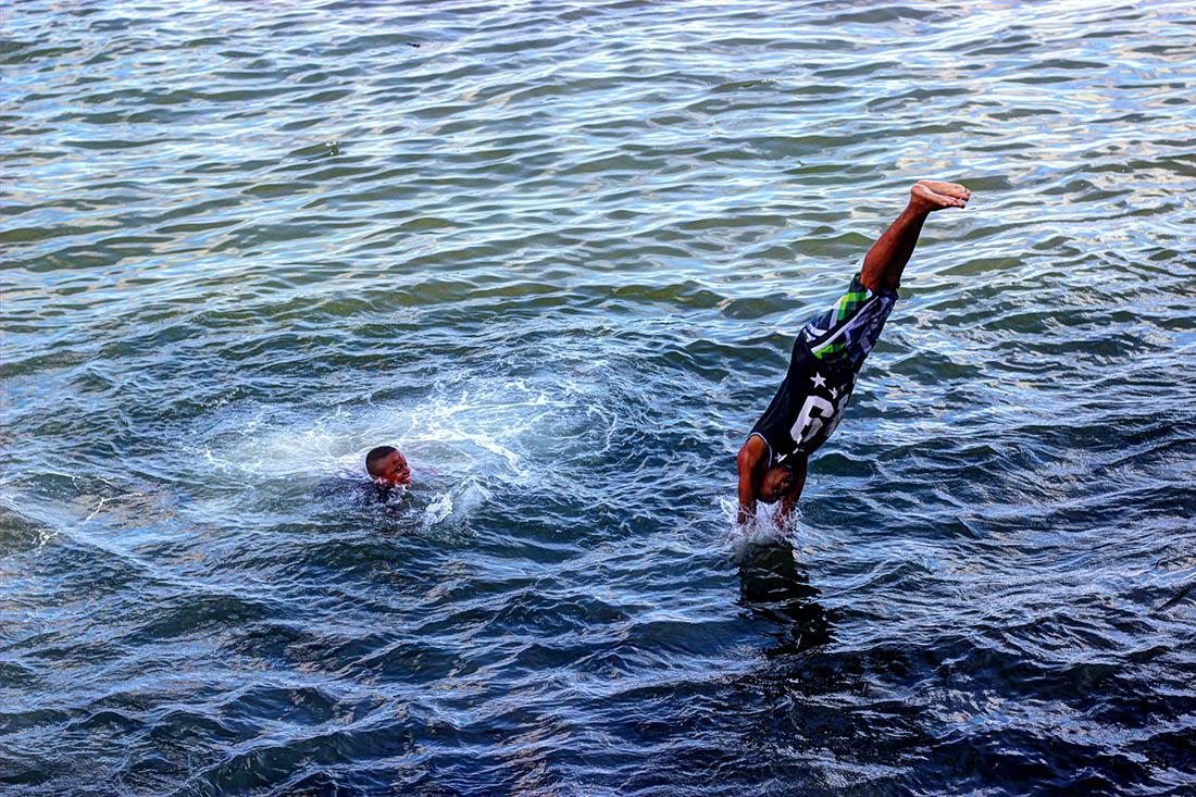 Lamu Town_Boy jumping from jetty.3