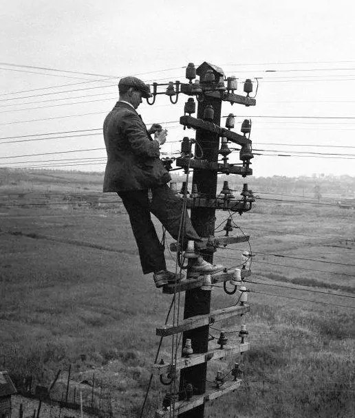Utility Lineman using Felt Hat for Electrical Safety.