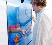 child & parent looking through Hi-lo 1