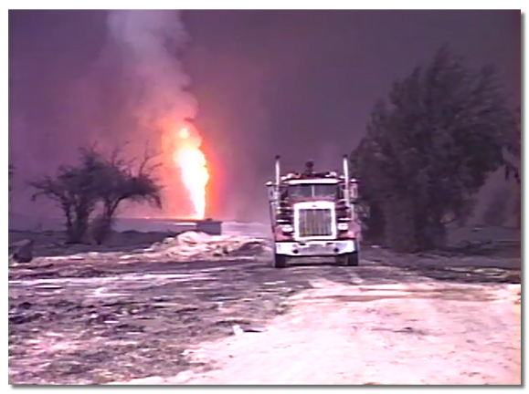 Kuwait gulf war showing a Smokey fire truck and fire in background