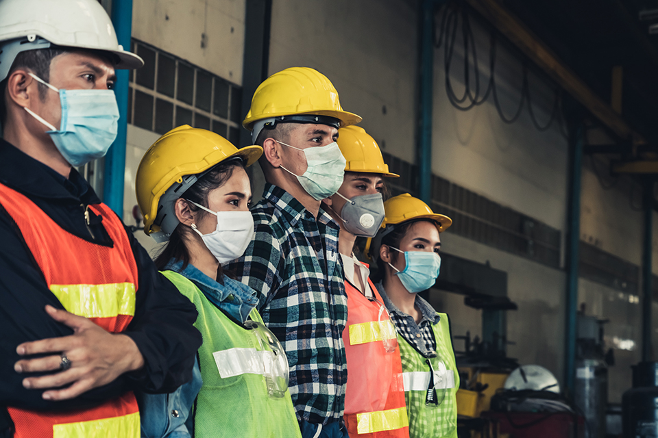 Workers wearing ppe and masks