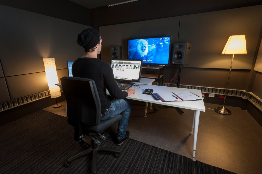 Man working in the Adelaide Studios Sound Edit Studio, photo by Sam Oster