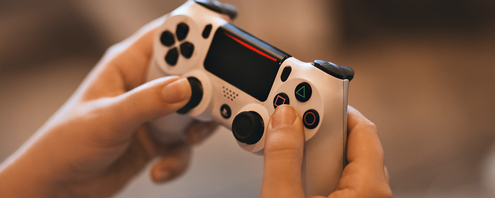 Person holding gaming controller