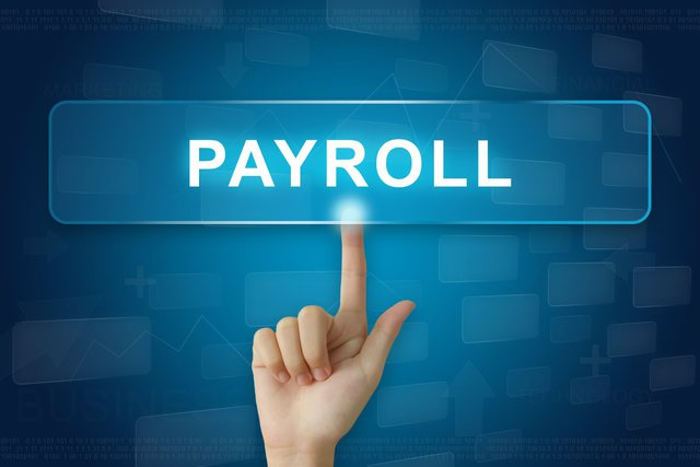 finger pointing to payroll sign