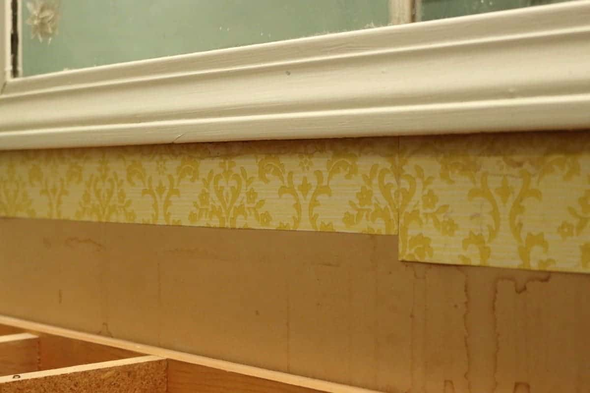 1970's era yellow wall paper in bathroom