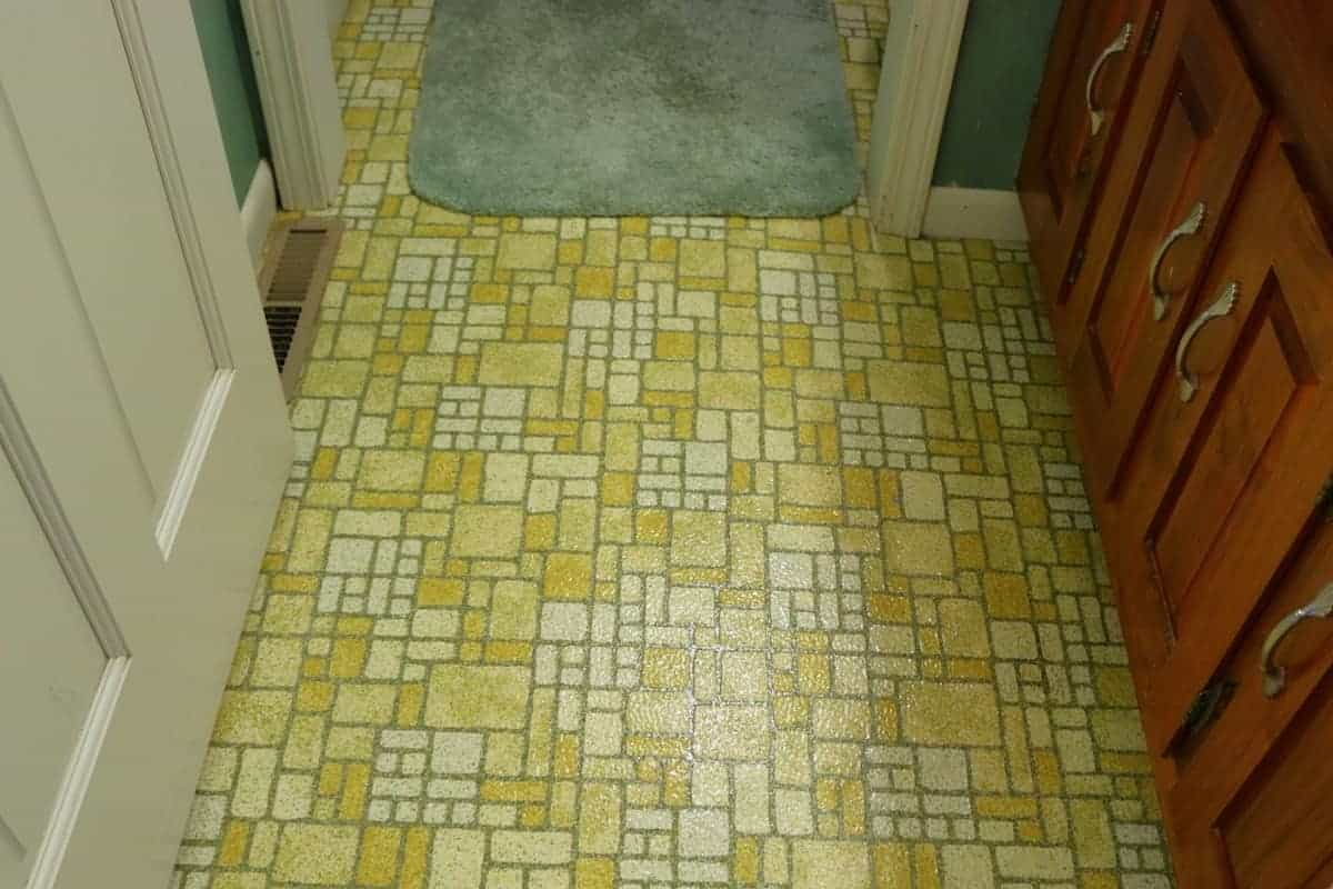 Photo of original 1970's yellow linoleum floor prior to being covered with luxury vinyl tile