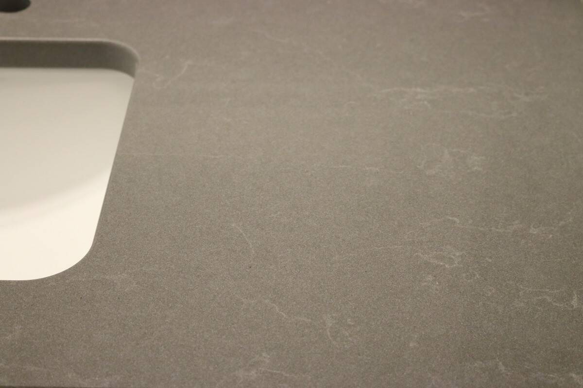 Dark grey quartz countertop with white sink material choices