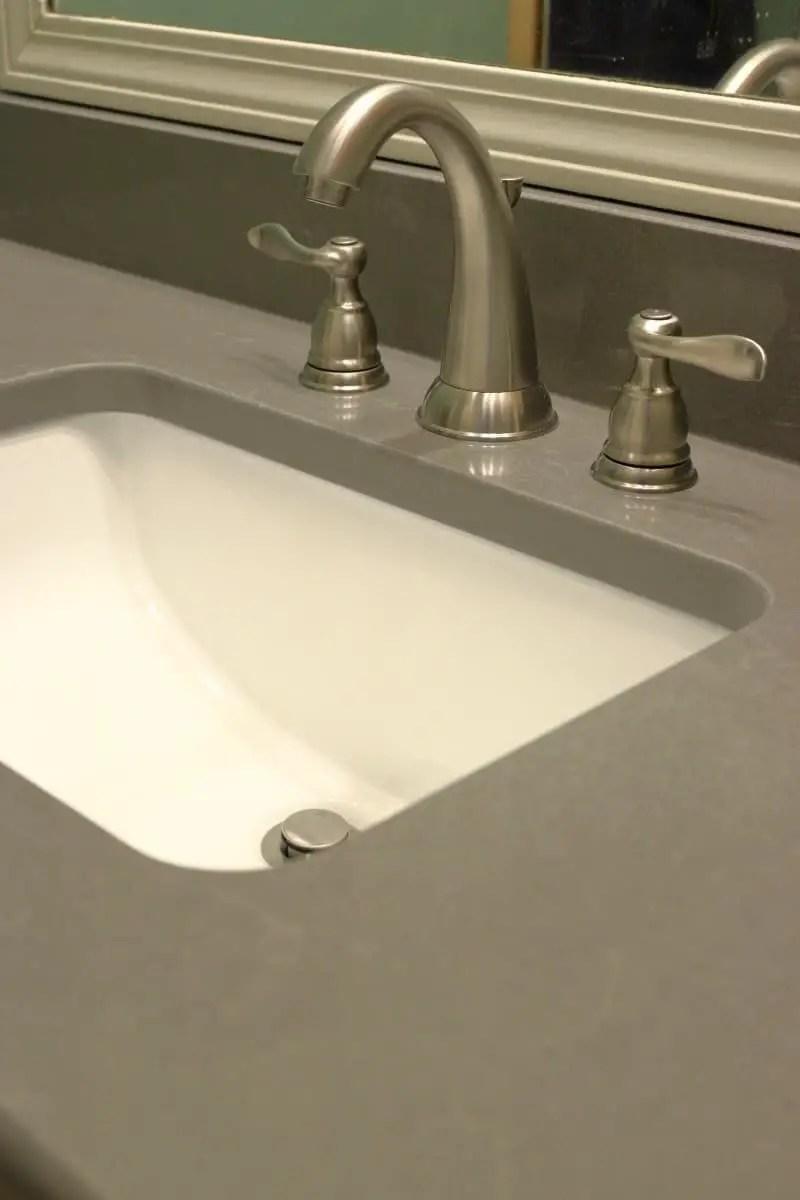 Bathroom remodel - dark grey quartz countertop with white sink