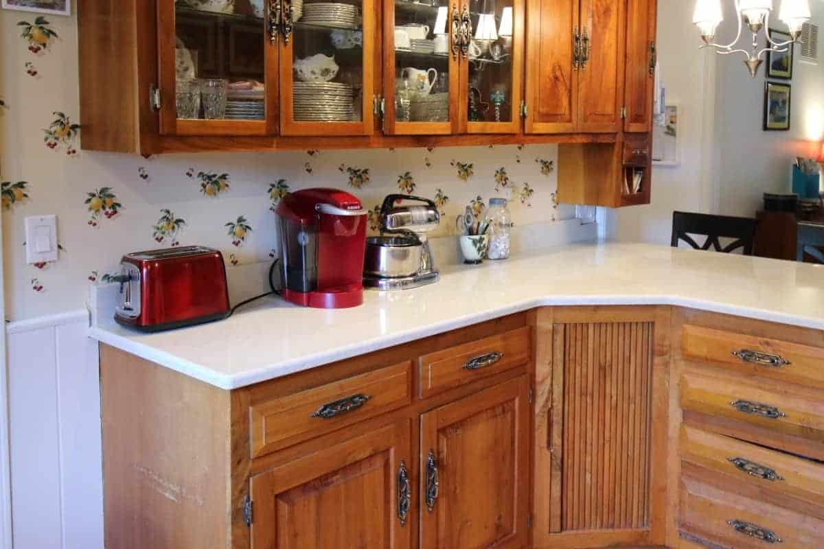 Kitchen remodel with hickory cabinets and white quartz countertop