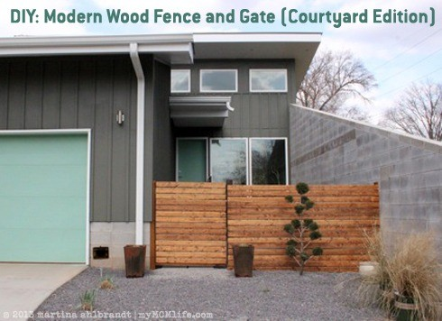 Modern garden gate and fence with horizontal slats