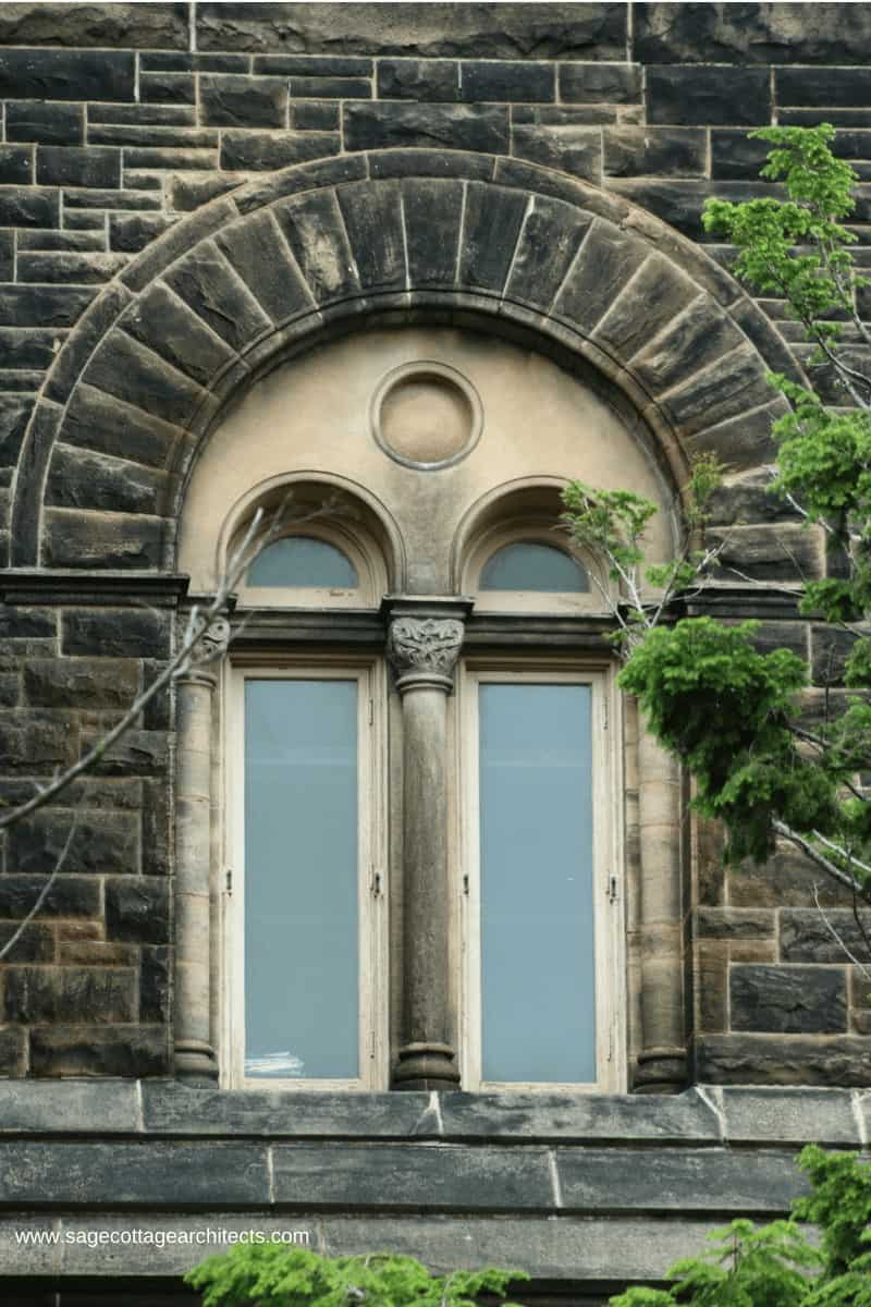 Richardsonian Romanesque building with paired windows, colonnettes and arched frame