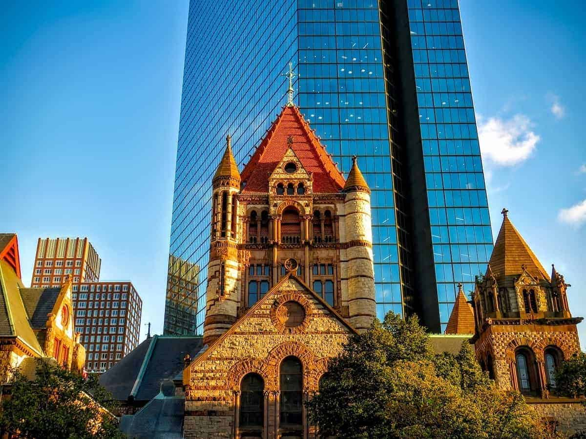 Richardsonian Romanesque homes are based on this stone church in front of modern skyscraper