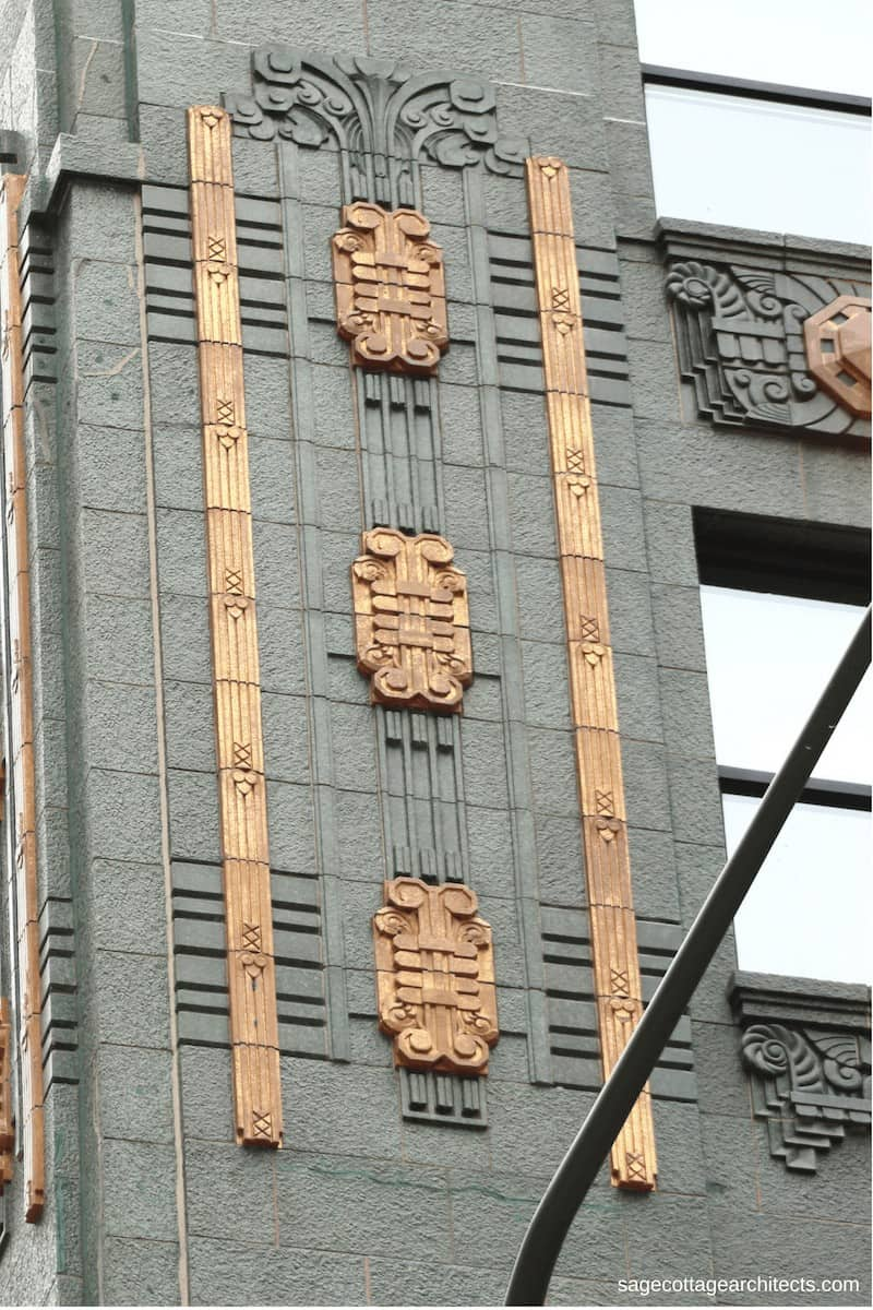 Green terra cotta walls of the Carbide and Carbon Building with bronze Art Deco details