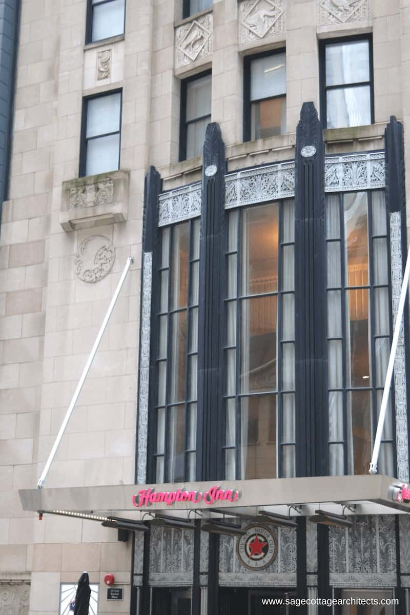 Art Deco exterior with limestone cladding, black columns and nickel decorative spandrel panels.