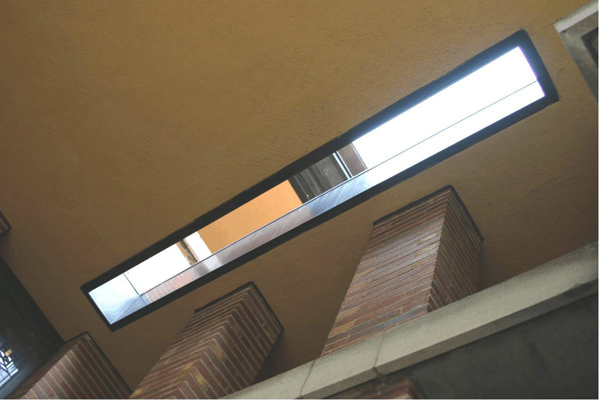 Long rectangular exterior skylight in cream stucco ceiling at the Robie House.