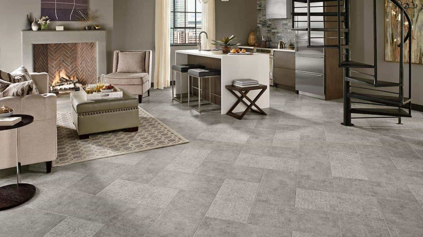 Photo of living room with grey patterned floor made of luxury vinyl tile