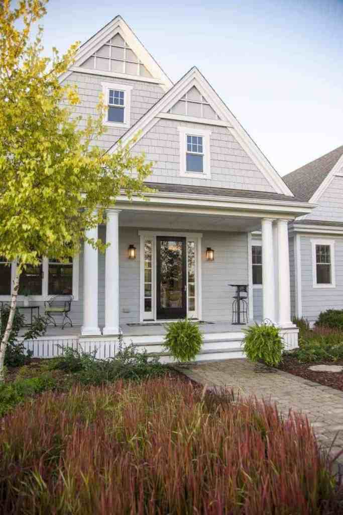 Photo of farmhouse style home with large front porch.