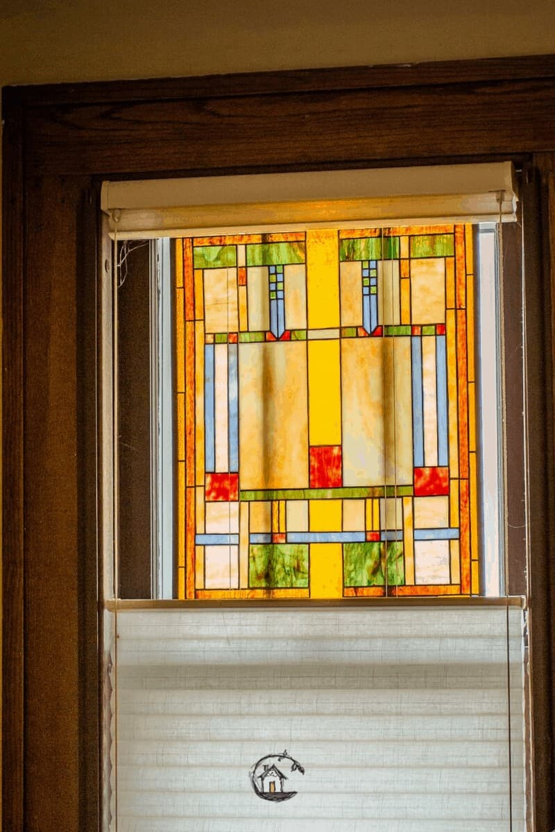 Photo of yellow, green, and red stained class window seen on Old House Society Tour.
