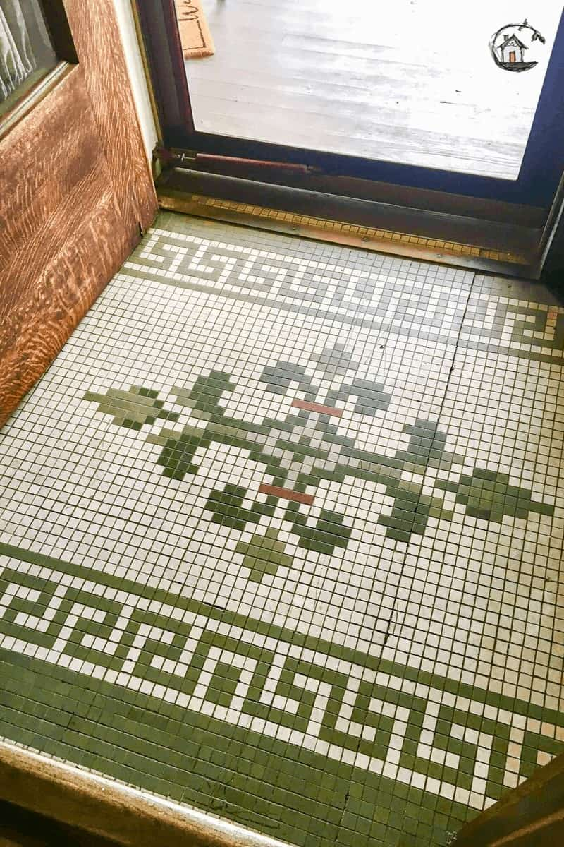 Photo of green and white tile mosaic floor on old house tour.