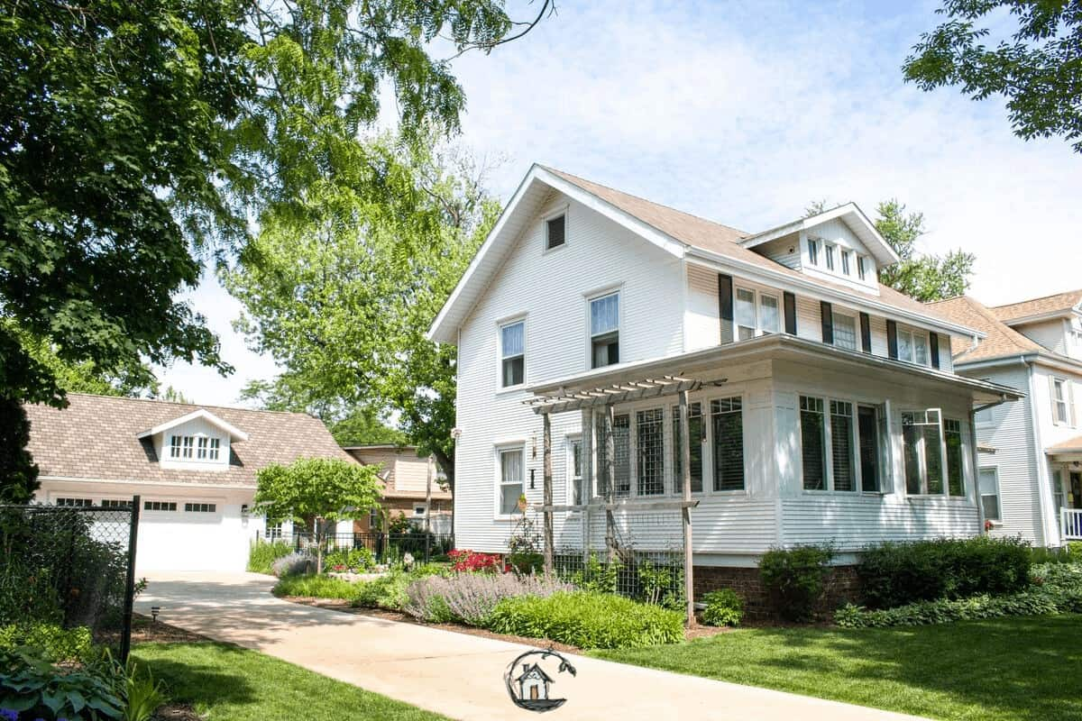 Photo of white American Foursquare home seen on Old House Society Tour