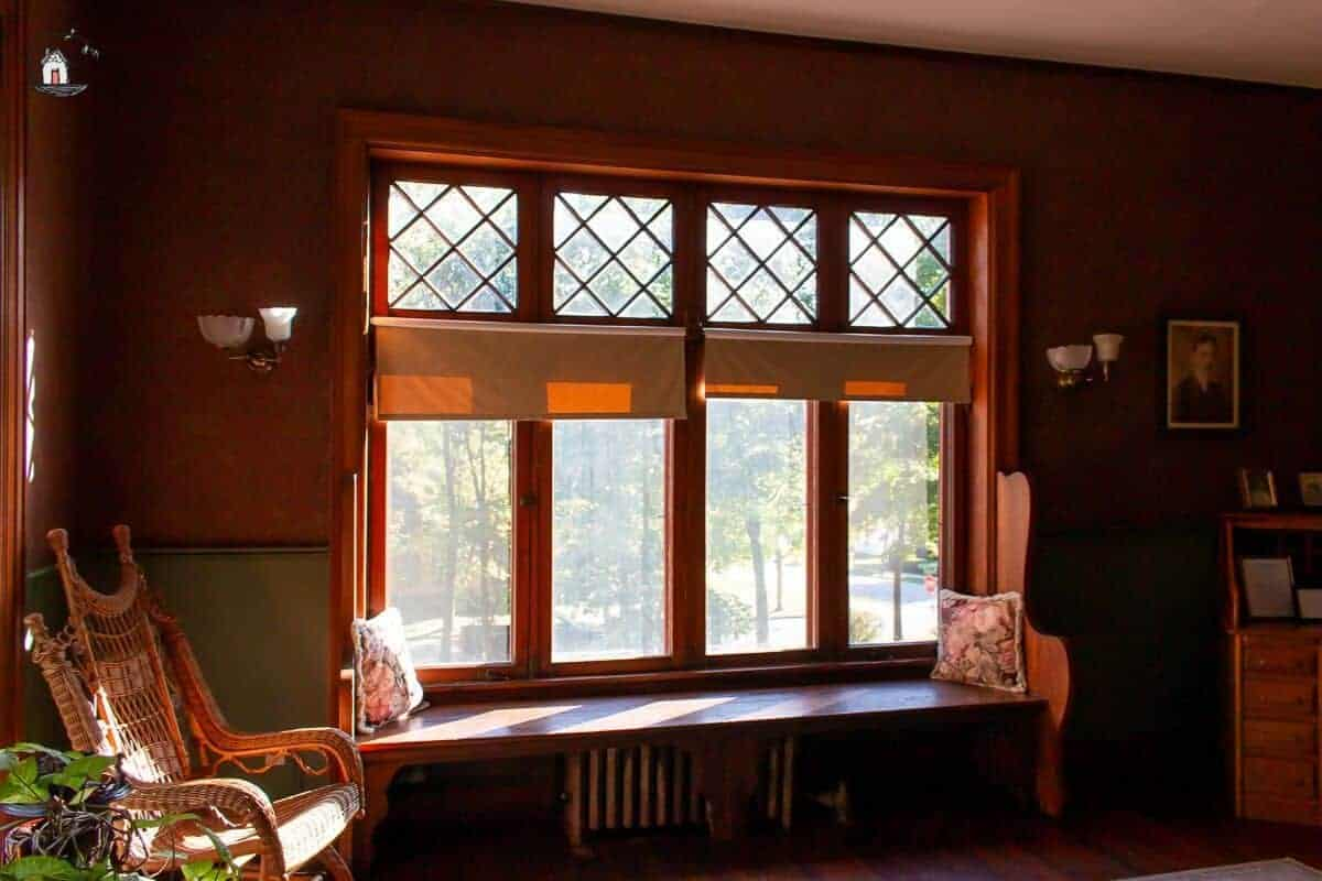 Photo of four windows with diamond panes in the study of the Vrooman Mansion.