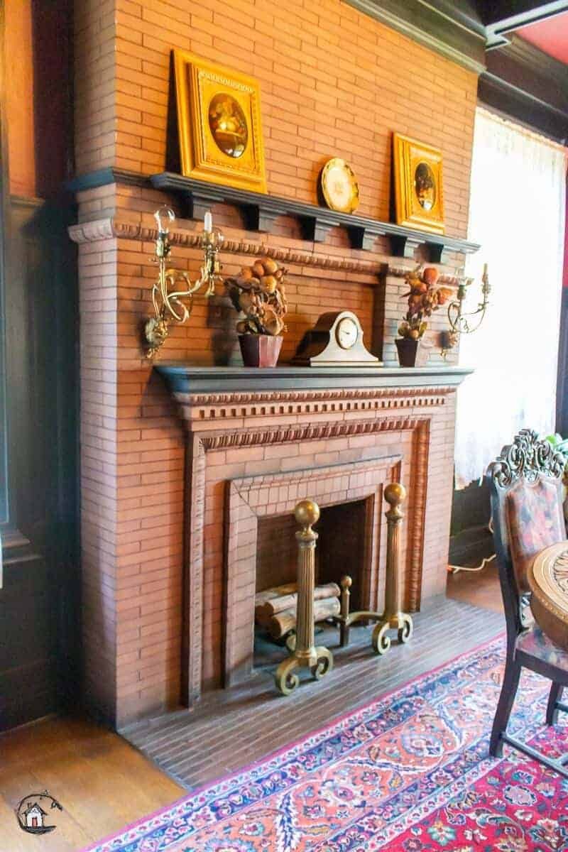 Photo of brick fireplace in the Vrooman Mansion.