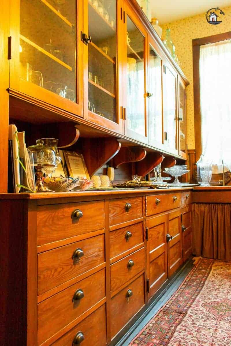 Photo of wood cabinets in the Vrooman Mansion butler's pantry.