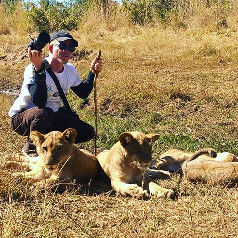 PhotoOfTheDay: Afrotourist Niyi David Chills Out With The Lions Of Zimbabwe