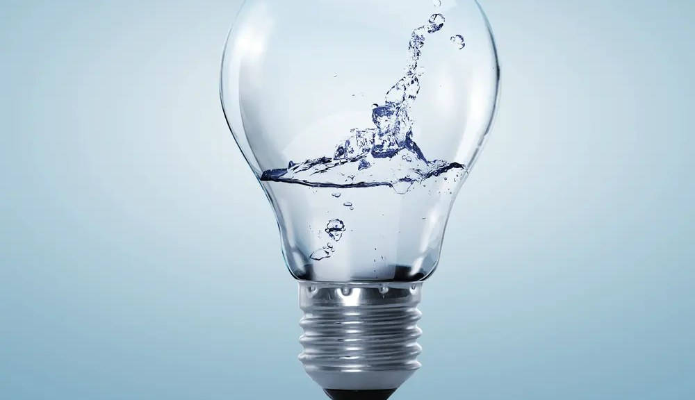 Swimming pool energy saving tips represented by water in a light bulb