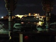 Enjoying a drink in the evening in the Tiki bar, as cruise ship goes by.