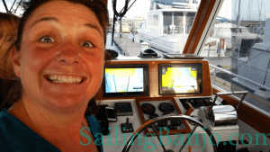 Shannon at the helm of a Grand Banks Powerboat
