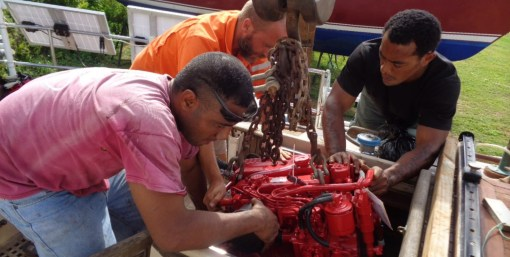 The boatyard guys get creative - lowering the engine down to Rick gearbox first