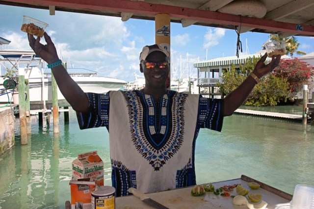 Showbo showing off his conch salad and scorched conch dishes
