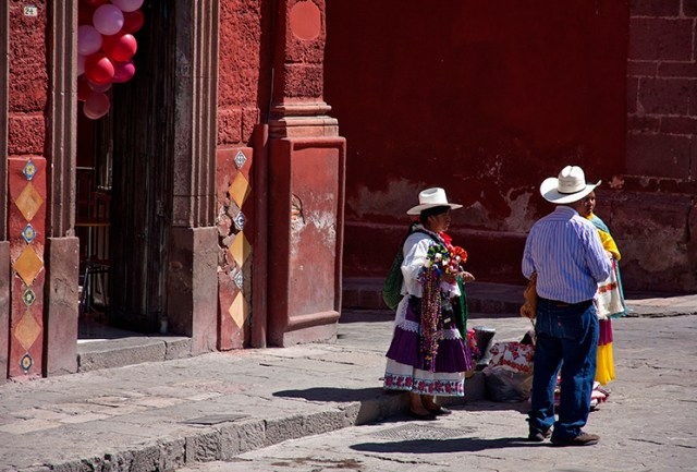 Street vendors sell goods by the church as the town sets up for the Fiesta San Miguel de Allende