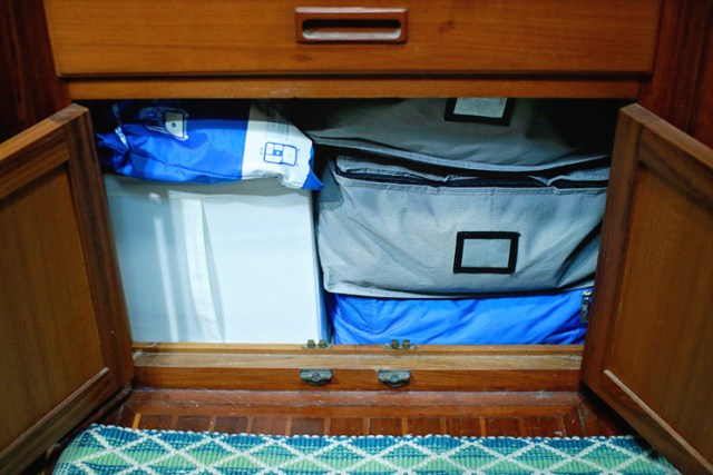 Canvas bags keep clothes organized on your sailboat.