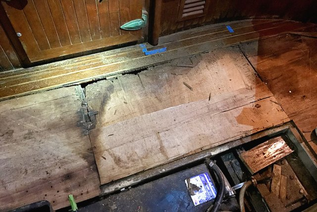 Water damaged 35-year-old plywood flooring underlayment aboard our Vagabond 42.