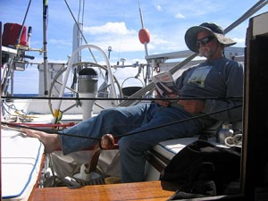 The tiller is tied while the captain researches the problem in the calm of day