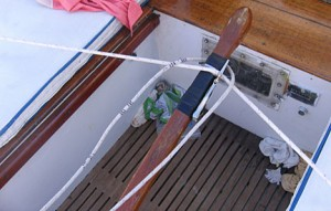 the wind vane steering lines are attached to the tiller with a vise clamp and hose clamps