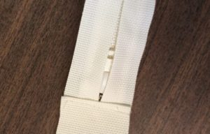 Sew the boxing to the zipper panel to create the zipper plaque