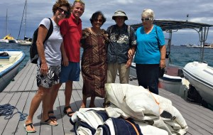 Ginger, Lanny, Rufina, Gary, and Phyllis at the sail donation. Photo: Cary Evarts