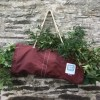 Forage bag hanging on a wall