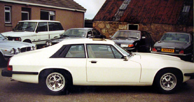 Side shot of the white Jaguar XJS used in The Return of The Saint