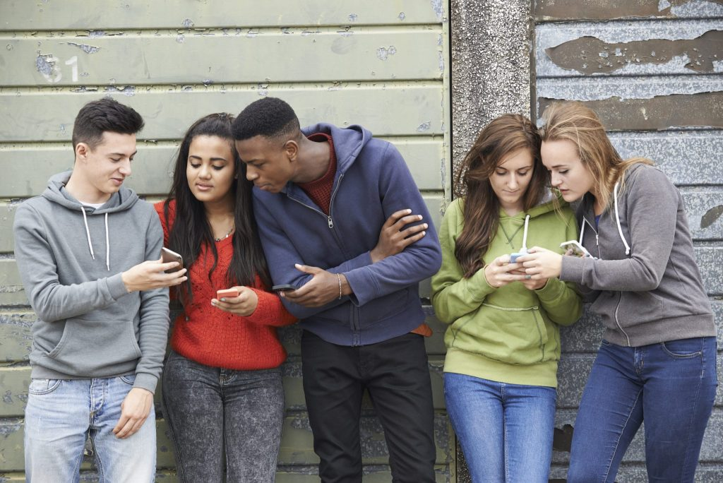 teenagers using cell phones