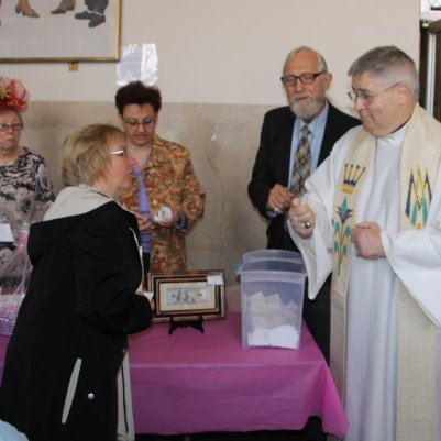 Pulling the winning ticket for the Rosary Society Mothers Day Drawing
